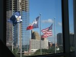 Flags flying in front of the George R Brown