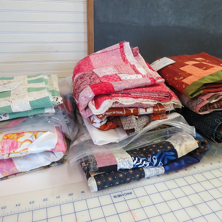 stack20of20tops20awaiting20backings20and20quilting-m