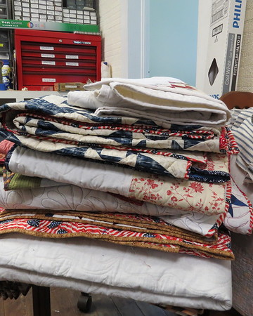 stack20of20completed20quilts20to20be2020put20into20storage-m